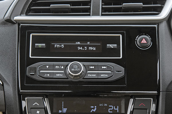 Old-school Honda stereo unintuitive to use and lacks features.