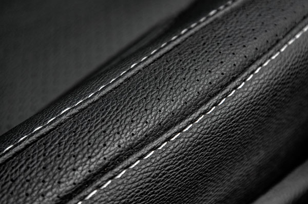 Contrast stitched, perforated faux-leather feels suitably upmarket.