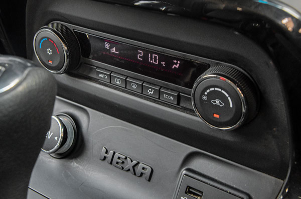 Auto climate control is single-zone only; AC cools well but blower whirr is noisy even at lowest speed.
