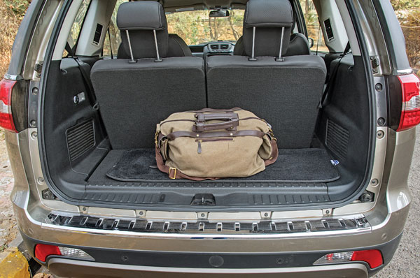 Even with all rows up it'll take a suitcase easily if you straighten the seatbacks.