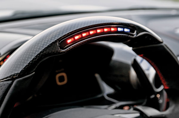 Digi tachometer and carbon-fibre finish on steering.