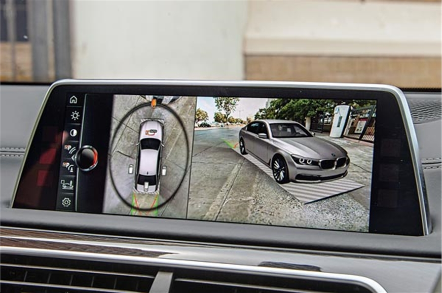 Parking cameras show surroundings with respect to a 3D im...