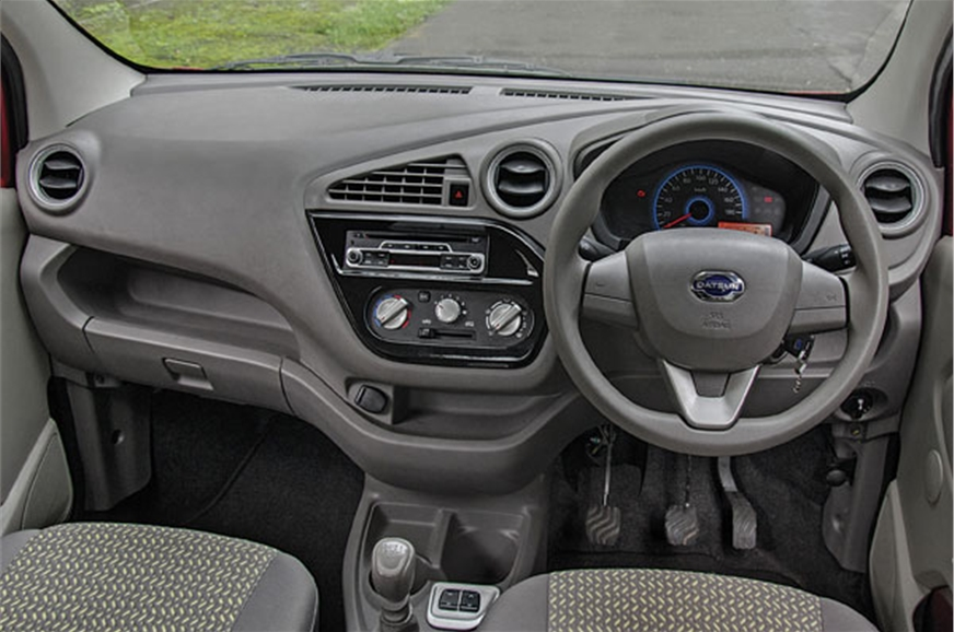 The dashboard design is funky yet functional. Steering wh...