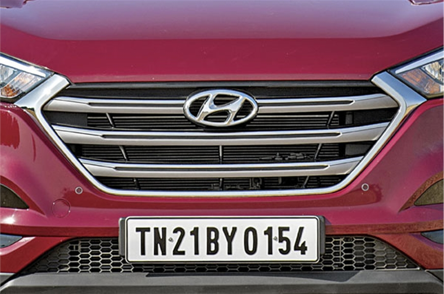 The now familiar large hexagonal grille dominates the Tuc...