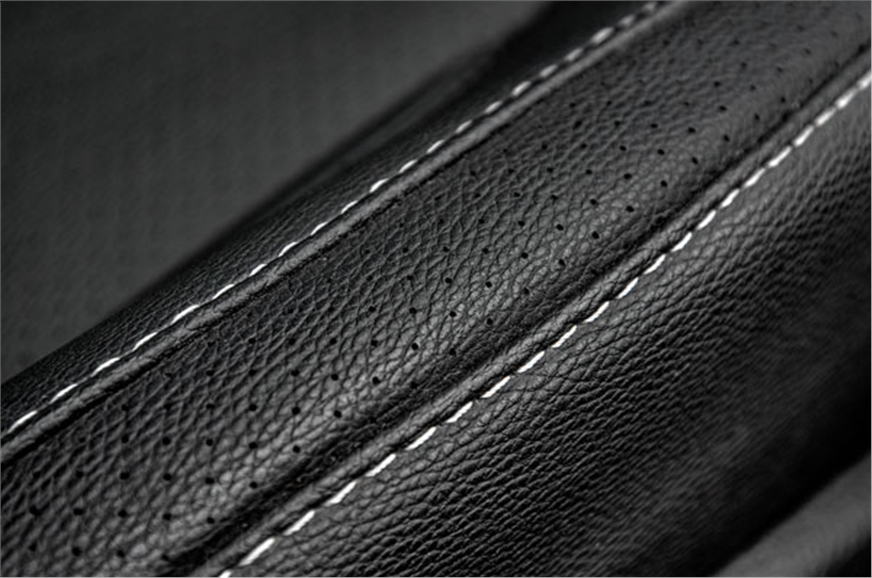 Contrast stitched, perforated faux-leather feels suitably...