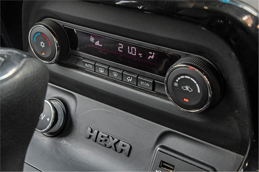 Auto climate control is single-zone only; AC cools well b...