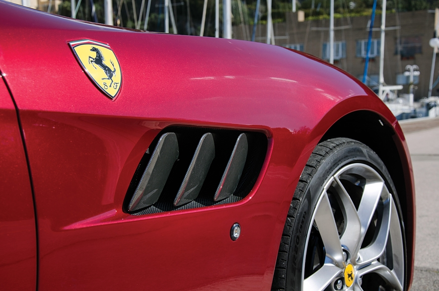 Carbon-fibre 'gills' look neat; note huge wheel arch.