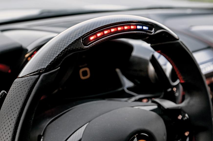 Digi tachometer and carbon-fibre finish on steering.