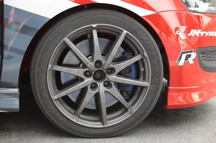 "Upgraded brakes encompass cover the 17"" wheels completely. ABS-assisted as well."