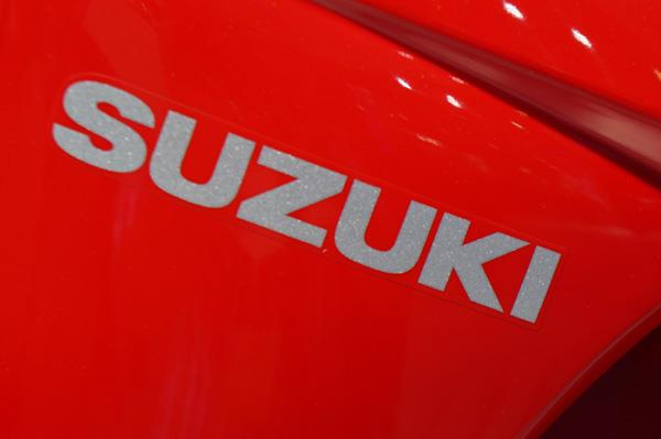 Suzuki proudly poses it's name on the front apron of its Let's scooter.