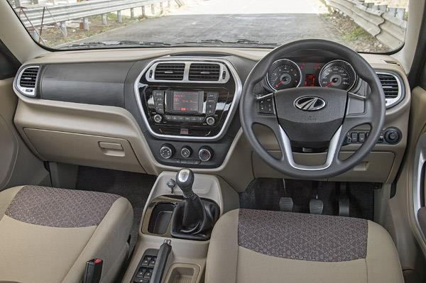 High driving position gives a commanding view ahead. Two-tone dashboard and four-spoke steering wheel nicely designed.