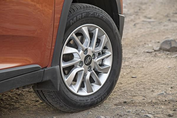 Small 14-inch wheels add to KUV100's disproportionate stance.