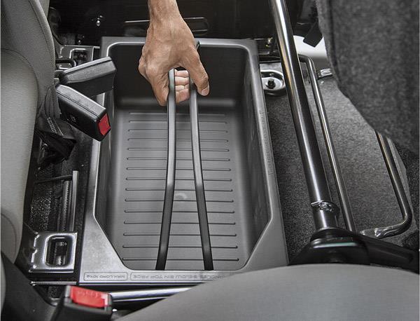 Bucket bay hidden under front seat useful for storing essentials.