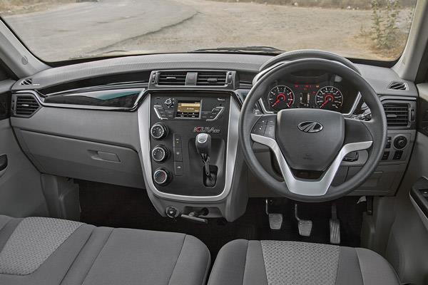 Interior looks upmarket. Bowed dash is a standout style element. Pull-type handbrake inconvenient.