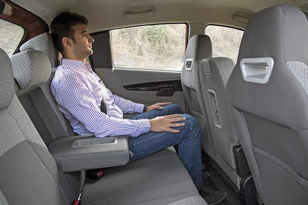 Rear seat is roomy and very comfy. Flat bench and floor good for three.