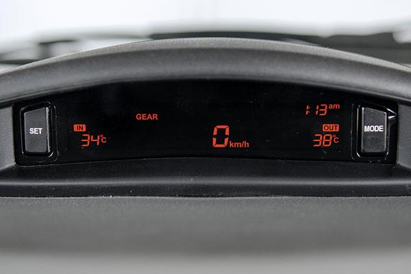 Fuel computer, optimal gear display and other info sit on dash top, separate from regular odometer.