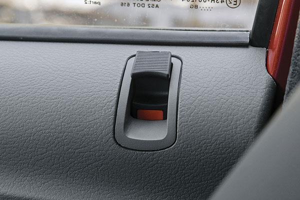 No central lock/unlock button; you have to lift the knob.
