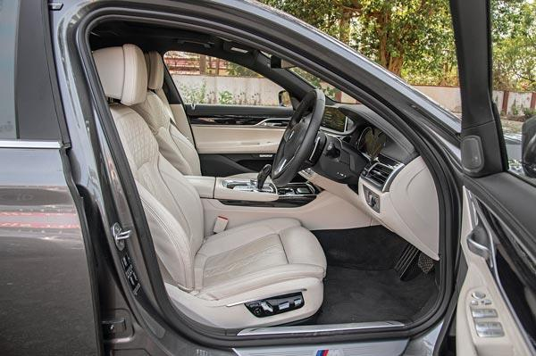 Large and comfy as they are, the front seats don't get cooling or massage feature.