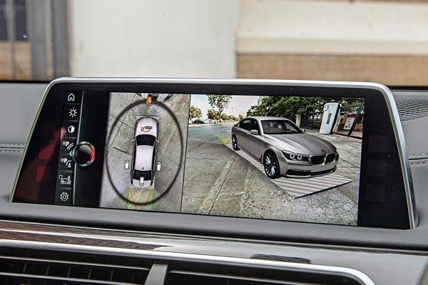 Parking cameras show surroundings with respect to a 3D image of the car. Gestures control view angle.
