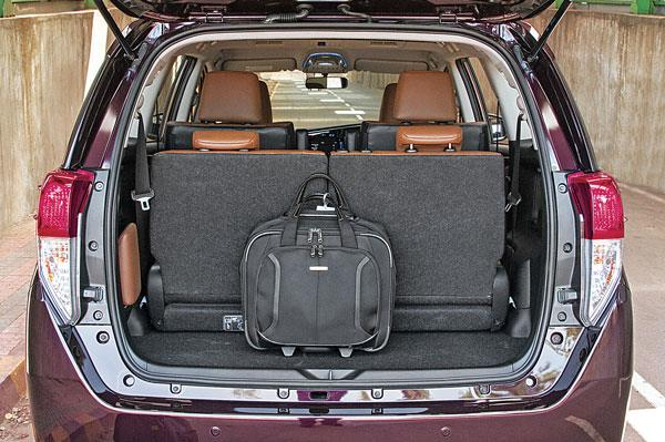 With third row up, boot storage still possible. Handy space for head restraint.
