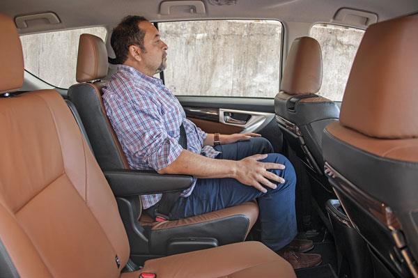 Comfortable upright. Reclined, armrest moves upward, back gets pushed outward.