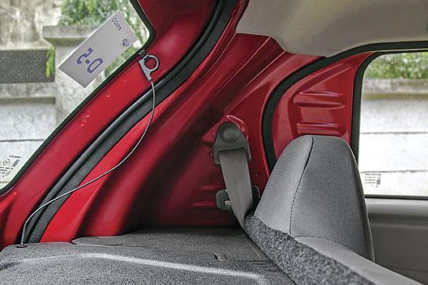 Exposed body panels give a bare-bones feel to the cabin.
