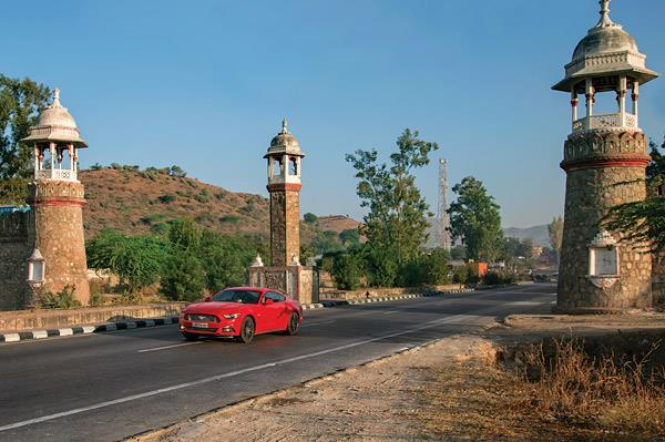 The Mustang powers out of Udaipur; big V8 makes shrinking the miles dead easy.