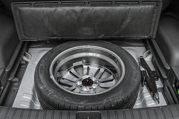 No space-saver but full-size spare mounted on the same alloy wheel.