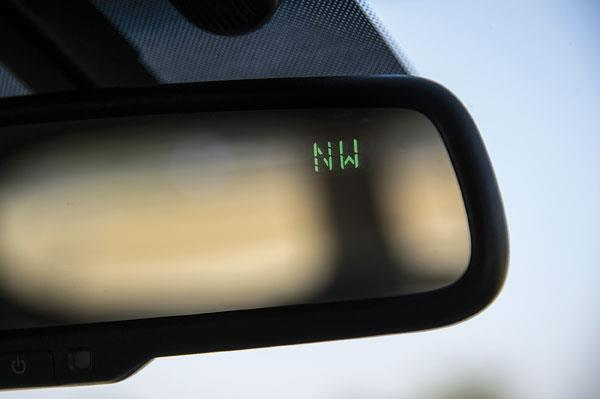 More feel-good than useful, inside rear view mirror has digital display for compass heading.