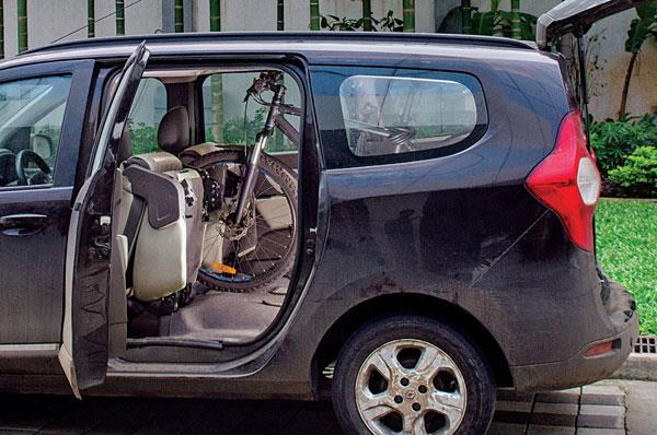 Our staffer Siddhant's bicycle fit perfectly in the MPV's spacious cabin.