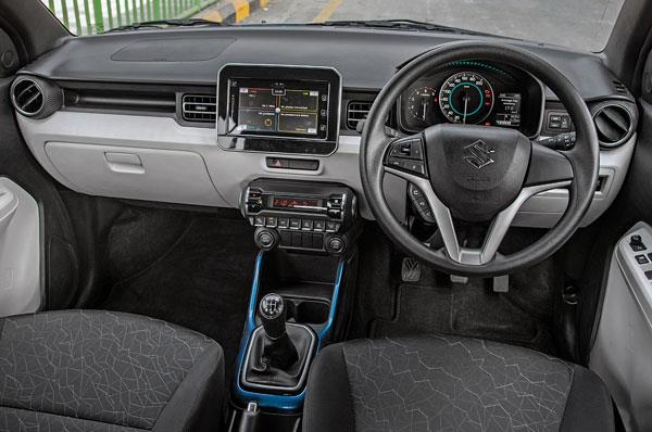 Ignis dash looks contemporary and body-coloured panels help liven cabin.