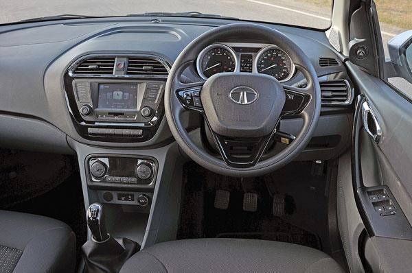 The Tigor shares its dashboard with the Tiago. However, the revised centre console is home to a new touchscreen infotainment system and automatic climate control dials.