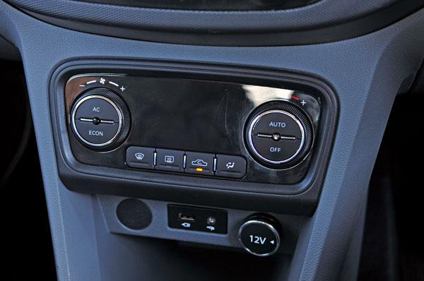 Tigor gets auto climate control. Blank space between knobs looks odd.