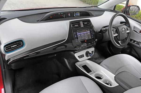 Layered dashboard looks interesting. White surfaces make cabin feel airier.