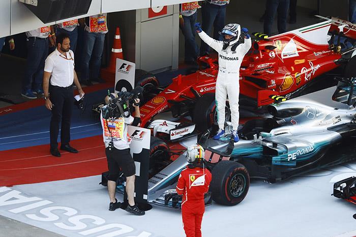 Russian GP:  Bottas resists Vettel for maiden F1 win