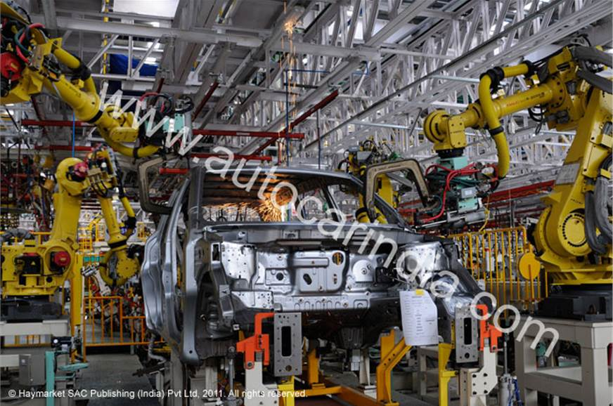 Sixteen robots do various jobs in building the XUV500-15 ...