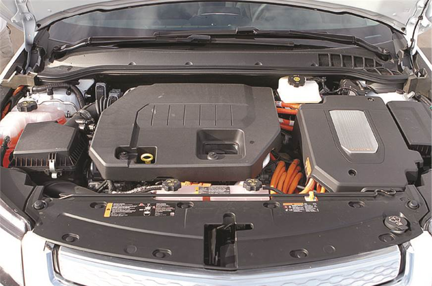 Conventional combustion engine plus high-voltage orange w...