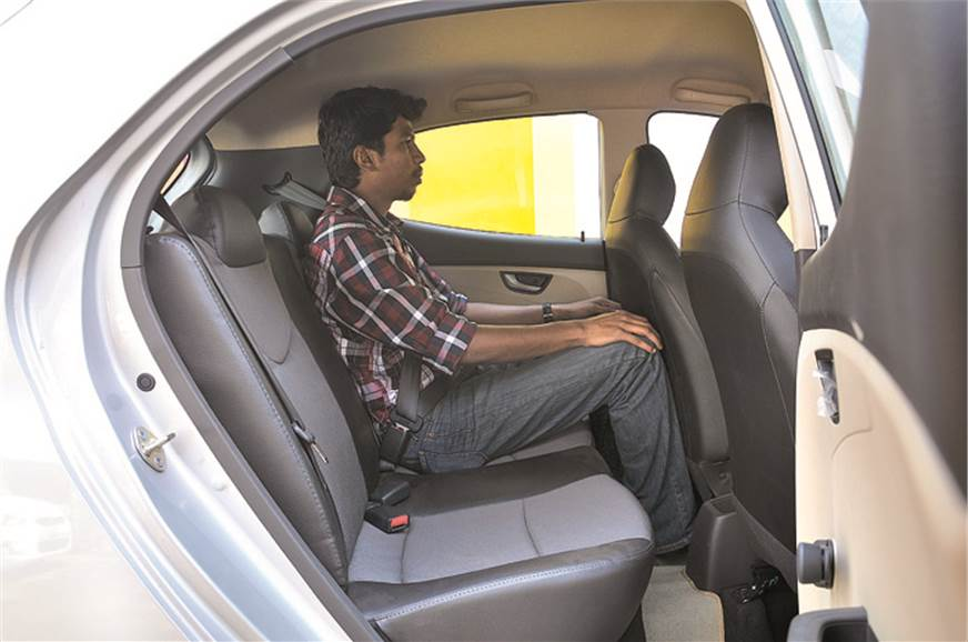 Rear seat not very spacious and window line is quite high.