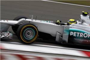 Rosberg flies to maiden pole in China