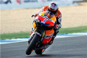 Stoner takes points' lead with Estoril win