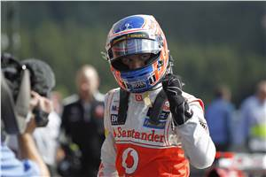 Button storms to pole at Belgian GP