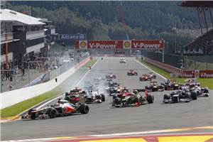 Button dominates dramatic Belgian GP