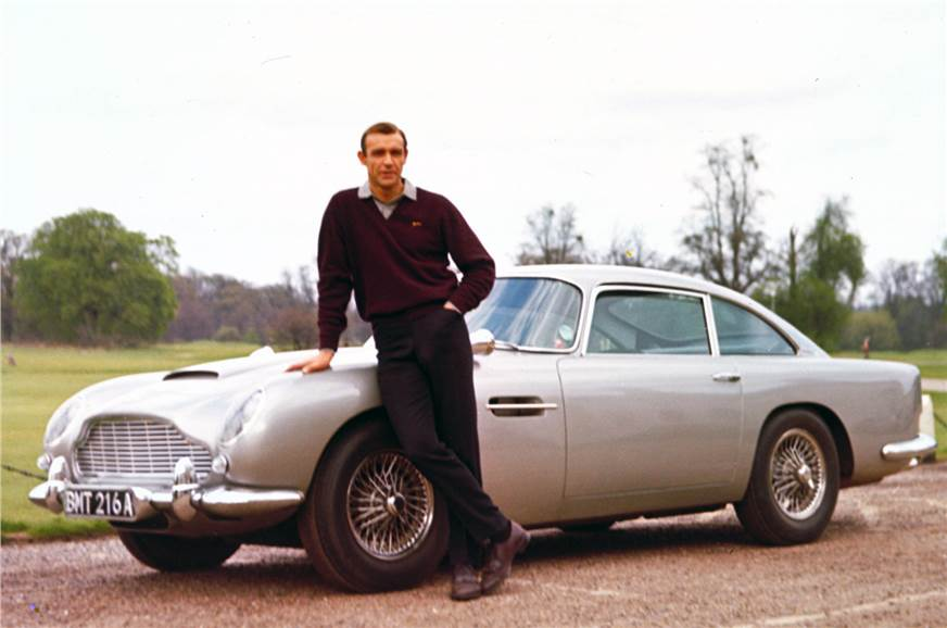 Sean Connery poses with the DB5 in Goldfinger