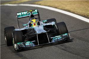 Hamilton grabs first pole with Mercedes