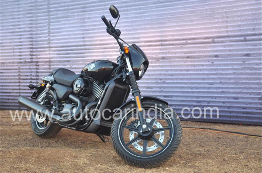 Harley-Davidson's pitch black paint scheme highlights the...