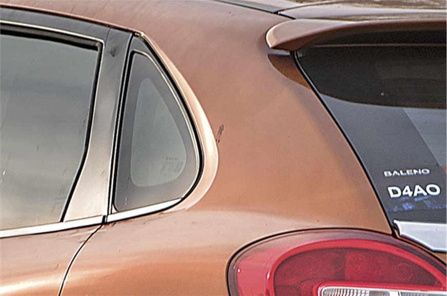 Rear quarter glass is distinctive and makes the cabin fee...