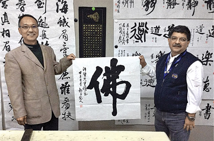 Khan holding a Chinese painting dedicated to him at the 2...
