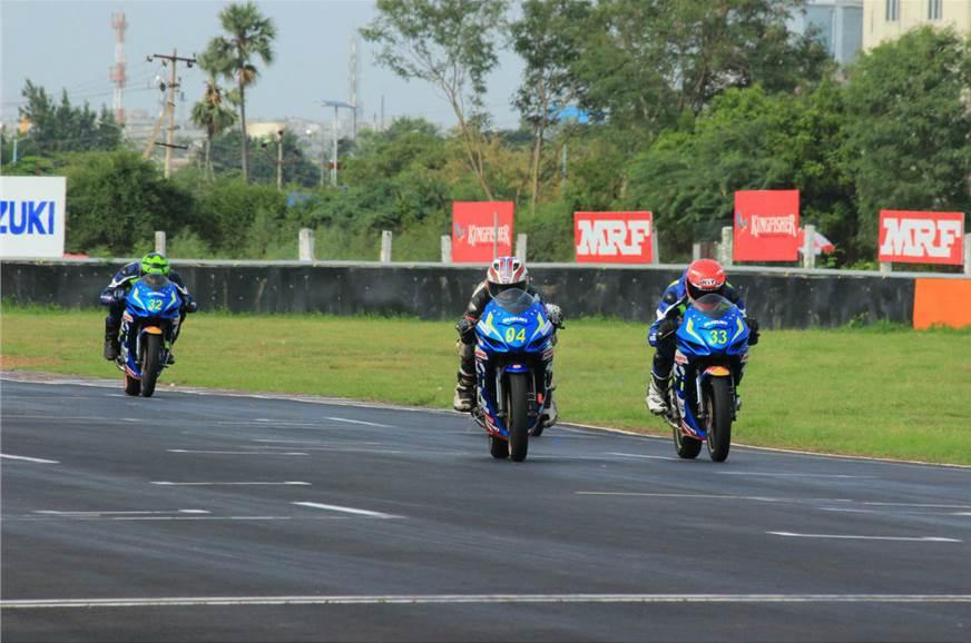 Aaron Gunawardena(13) races head to head with Gixxer Novi...