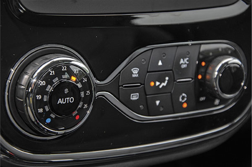 Air-con controls similar to Duster's.