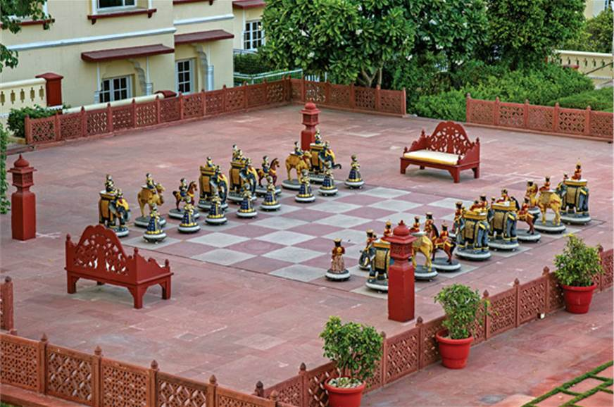 A life-size chessboard with intricate pieces is a highlig...